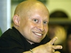 Verne Troyer, who played 'Mini-me' in the Austin Powers movies, mugs for a photograph at the World of Wheels on Sat., April 10, 2004 at the Winnipeg Convention Centre.