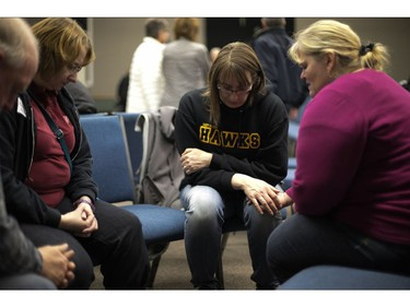 """Families, friends and supporters of the Humboldt hockey team gathered in Nipawin's Apostolic Church as they wait for news of loved ones on April 6, 2018 after a bus carrying a junior ice hockey team collided with a semi-trailer truck between Tisdale and Nipawin, Saskatchewan province, killing 14 people. Hockey-mad Canada was in mourning on Saturday after a bus carrying a junior ice hockey team collided with a semi-trailer truck in Saskatchewan province, killing 14 people.In a country where love of the sport is almost a religion, the crash sparked an outpouring of grief among players and fans on social media, while national political leaders expressed their sympathies.""""We can now confirm 14 people have died as a result of this collision,"""" the Royal Canadian Mounted Police said in a statement, which did not say how many of the victims were players or coaches of the Humboldt Broncos team."""