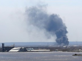 Smoke from an explosion at the Husky Energy oil refinery in Superior, Wisconsin on April 26, 2018 is seen from across the lake in Duluth, Minnesota.