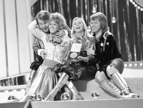 FILE - In this April 6, 1974 file photo, Swedish pop group ABBA celebrate winning the 1974 Eurovision Song Contest on stage at the Brighton Dome in England with their song Waterloo. From left, Benny Andersson, Anni-Frid Lyngstad (Frida), Agentha Faltskog, and Bjorn Ulvaeus. The members of ABBA announced on Friday April 27, 2018, they have recorded new material for the first time in 35 years.
