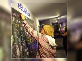 Justin Bieber signs a message board at the Stratford Perth Museum on Friday, April 27, 2018 in this handout photo. Justin Bieber's grandparents are known to frequent an exhibit on him in his hometown of Stratford, Ont. But on Friday the venue got an unexpected visit not just from them, but also from the pop superstar himself.THE CANADIAN PRESS/HO, John Kastner