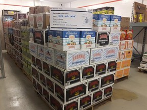 In this Twitter photo, Canada Border Services Officers show off 6 pallets of undeclared beer seized at the St-Bernard-de-Lacolle border crossing.