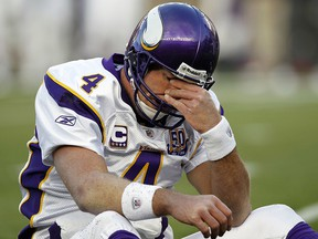 In this Oct. 31, 2010, file photo, Minnesota Vikings quarterback Brett Favre rubs his eyes after being hit  in Foxborough, Mass. (AP Photo/Winslow Townson, File)