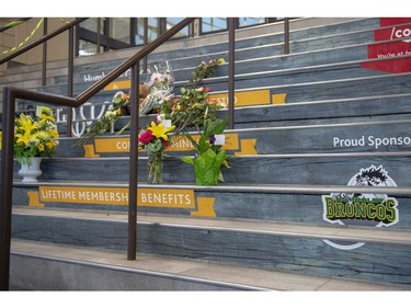 A memorial of flowers and cards sits on the stairs leading into Elgar Petersen Arena, home of the Humboldt Broncos hockey team, in Humboldt, Sask., on Saturday, April 7, 2018. RCMP say 14 people are dead and 14 people were injured Friday after a truck collided with a bus carrying a junior hockey team to a playoff game in northeastern Saskatchewan. Police say there were 28 people including the driver on board the Humboldt Broncos bus when the crash occurred at around 5 p.m. on Highway 35 north of Tisdale.