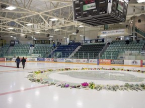 Flowers and other items continue to be added to a memorial on centre ice at Elgar Petersen Arena in Humboldt, Sask., on Monday, April 9, 2018.