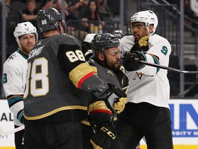 Evander Kane of the San Jose Sharks cross-checks Pierre-Edouard Bellemare of the Vegas Golden Knights at T-Mobile Arena on April 26, 2018 in Las Vegas. (Christian Petersen/Getty Images)