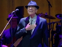 Montreal singer Leonard Cohen acknowledges cheers of the crowd as he takes the stage for his concert at the Bell Centre on Nov. 28, 2012.