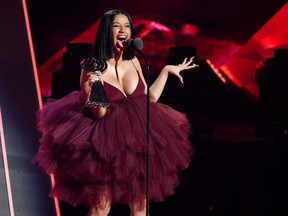 In this March 11, 2018, file photo, Singer Cardi B accepts the Best New Artist award during the 2018 iHeartRadio Music Awards at The Forum in Inglewood, Calif.