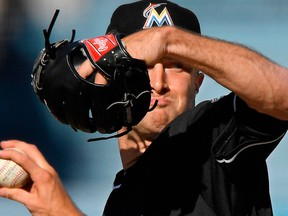 Miami Marlins starting pitcher Trevor Richards throws to the plate during the second inning of a baseball game against the Los Angeles Dodgers on April 25, 2018
