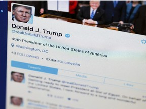 This April 3, 2017, photo shows President Donald Trump's tweeter feed on a computer screen in Washington.