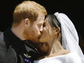Prince Harry and Meghan Markle kiss on the steps of St George's Chapel in Windsor Castle after their wedding. (Ben Birchhall/pool photo via AP)