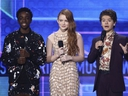 Kaleb McLoughlin, from left, Sadie Sink, and Gaten Matarazzo introduce a performance by Alessia Cara and Zedd at the American Music Awards at the Microsoft Theater on Sunday, Nov. 19, 2017, in Los Angeles.