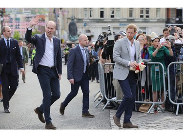 WINDSOR, ENGLAND - MAY 18:  (L-R)  Prince William, Duke of Cambridge and Prince Harry embark on a walkabout ahead of the royal wedding of Prince Harry and Meghan Markle on May 18, 2018 in Windsor, England.