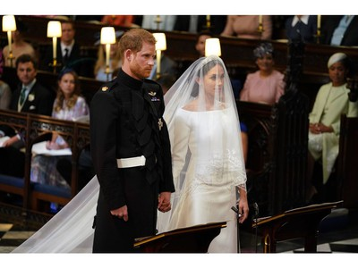 Britain's Prince Harry, Duke of Sussex (L) and US fiancee of Britain's Prince Harry Meghan Markle stand together for their wedding in St George's Chapel, Windsor Castle, in Windsor, on May 19, 2018.