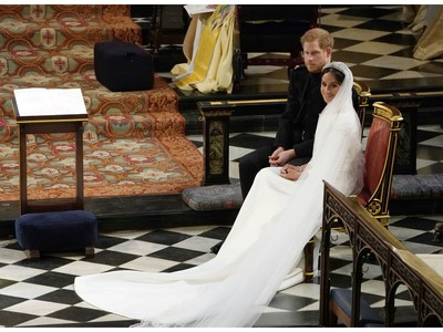 Britain's Prince Harry, Duke of Sussex (L) sits with US actress Meghan Markle (R) during the reading in St George's Chapel, Windsor Castle, in Windsor, on May 19, 2018 during their wedding ceremony.