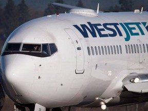 A Westjet Boeing 737-700 taxis to a gate after arriving at Vancouver International Airport in Richmond, B.C., on Monday February 3, 2014.