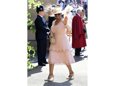 Oprah Winfrey waves as she arrives at St George's Chapel at Windsor Castle the wedding ceremony of Prince Harry and Meghan Markle at St. George's Chapel in Windsor Castle in Windsor, near London, England, Saturday, May 19, 2018. (Ian West/pool photo via AP) ORG XMIT: RWW107