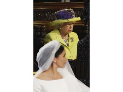 Britain's Queen Elizabeth looks on during the wedding of Prince Harry and Meghan Markle, front, at St. George's Chapel in Windsor Castle in Windsor, near London, England, Saturday, May 19, 2018. (Jonathan Brady/pool photo via AP) ORG XMIT: RWW187