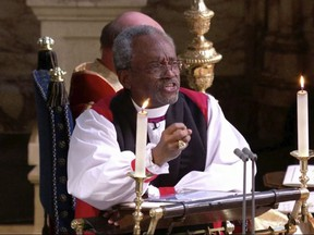 In this frame from video, the Most Rev. Michael Bruce Curry speaks during the wedding ceremony of Britain's Prince Harry and Meghan Markle at St. George's Chapel in Windsor Castle in Windsor, near London, England, Saturday, May 19, 2018.  (UK Pool/Sky News via AP)