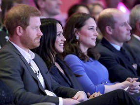 Britain's Prince William and Kate, Duchess of Cambridge, with Prince Harry, left, and his fiancee Meghan Markle, second left, attend the first annual Royal Foundation Forum in London, Wednesday Feb. 28, 2018. Under the theme 'Making a Difference Together', the event will showcase the programmes run or initiated by The Royal Foundation. (Chris Jackson/Pool via AP) ORG XMIT: LBJ131