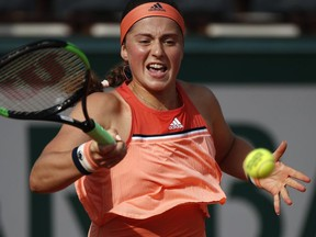 Latvia's Jelena Ostapenko returns the ball to Ukraine's Kateryna Kozlova during their first round match of the French Open at the Roland Garros Stadium in Paris, Sunday, May 27, 2018.