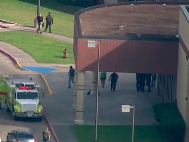 In this image taken from video law enforcement officers respond to a high school near Houston after an active shooter was reported on campus, Friday, May 18, 2018, in Santa Fe, Texas. The Santa Fe school district issued an alert Friday morning saying Santa Fe High School has been placed on lockdown.