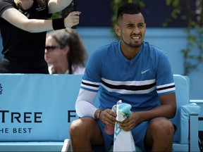 Australia's Nick Kyrgios looks on during a break in his semifinal tennis match against Croatia's Marin Cilic at the Queen's Club tennis tournament in London, Saturday, June 23, 2018. (AP Photo/Tim Ireland)