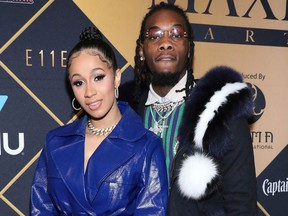 FILE- In this Feb. 3, 2018, file photo, Cardi B, left, and Offset arrive at the Maxim Super Bowl Party at the Maxim Dome in Minneapolis. A marriage certificate shows hip-hop stars Cardi B and the Migos' Offset were married months ago in Atlanta. Cardi B confirmed the marriage in a tweet Monday.