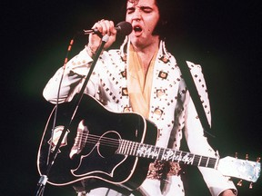 In this 1973 file photo, Elvis Presley sings during a concert.