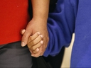 Darwin Micheal Mejia, right, holds hands with his mother, Beata Mariana de Jesus Mejia-Mejia, during a news conference after their reunion at Baltimore-Washington International Thurgood Marshall Airport, Friday, June 22, 2018, in Linthicum, Md. (AP Photo/Patrick Semansky)