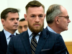 Mixed martial arts fighter Conor McGregor, centre, arrives at Brooklyn Supreme Court, Thursday, June 14, 2018, in New York.