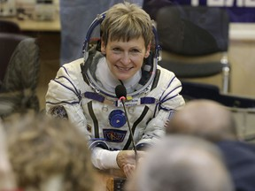 U.S. astronaut Peggy Whitson, member of the main crew of the expedition to the International Space Station (ISS), speaks with her relatives prior the launch of Soyuz MS-3 space ship at the Russian leased Baikonur cosmodrome, Kazakhstan on Nov. 17, 2016. (AP Photo/Dmitri Lovetsky)