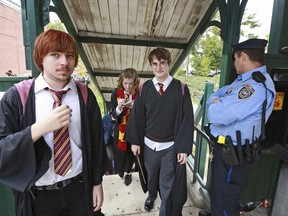 In this Oct. 18, 2014, photo, students from Chestnut Hill College in Philadelphia wear costumes to attend an annual festival based on the Harry Potter fantasy series conceived by British author J.K. Rowling, including Dan Lemoine, second from right, dressed as the title character; Mollie Durkin, second from left, dressed as the character Hermione Granger; and John Spiewak Jr., left, dressed as the character Ron Weasley, as they arrive at the festival in the Chestnut Hill neighborhood of Philadelphia. In 2018,
