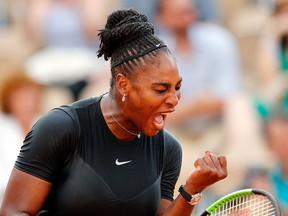 Serena Williams of the U.S. celebrates winning a point as she plays Germany's Julia Georges during their third round match of the French Open tennis tournament at the Roland Garros stadium, Saturday, June 2, 2018 in Paris.