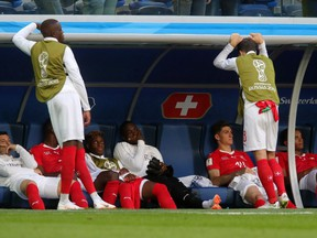 Switzerland players look dejected following their sides defeat in the 2018 FIFA World Cup Russia Round of 16 match between Sweden and Switzerland at Saint Petersburg Stadium on July 3, 2018 in Saint Petersburg, Russia. (Alexander Hassenstein/Getty Images)