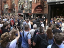 People queue outside the Cavern Club in Liverpool, England, before an exclusive gig by former Beatles member Paul McCartney, Thursday July 26, 2018. The former Beatle will take to the stage at the famous venue on Mathew Street for a one-off exclusive gig.