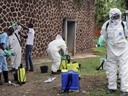 Congolese health officials prepare to disinfect people and buildings at the general referral hospital in Mbandaka, Congo on Thursday, May 31, 2018. (AP Photo/John Bompengo)