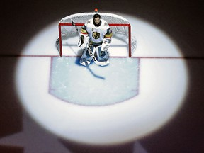 In this Feb. 6, 2018, file photo, Vegas Golden Knights goaltender Marc-Andre Fleury stands during the national anthem before a game in Pittsburgh. (AP Photo/Gene J. Puskar, File)
