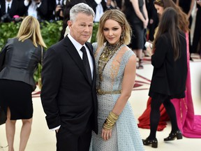 Recording artist David Foster and Katharine McPhee attend the Heavenly Bodies: Fashion & The Catholic Imagination Costume Institute Gala at The Metropolitan Museum of Art on May 7, 2018 in New York City. (Theo Wargo/Getty Images for Huffington Post)