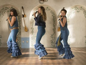 """This image released by Universal Pictures shows, from left, Jessica Keenan Wynn, Lily James and Alexa Davies in a scene from """"Mamma Mia! Here We Go Again."""" (AP Photo/Jonathan Prime)"""