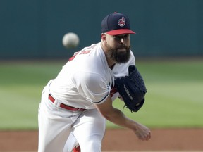 Cleveland Indians starting pitcher Corey Kluber delivers in the first inning of the team's baseball game against the New York Yankees, Thursday, July 12, 2018, in Cleveland.