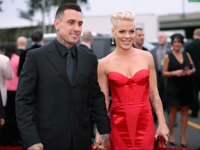Carey Hart and singer Pink attend the 56th GRAMMY Awards at Staples Center on January 26, 2014 in Los Angeles, California.