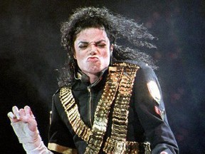 This Aug. 29, 1993 file photo shows pop star Michael Jackson performing the first of two concerts at the National Stadium in Singapore.