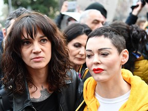 Italian actress Asia Argento (L) and U.S. singer and actress Rose McGowan take part in a march organized by 'Non Una Di Meno' (Me too) movement on March 8, 2018 as part of the International Women's Day in Rome. (Photo by / AFP)        (Photo credit should read ALBERTO PIZZOLI/AFP/Getty Images)