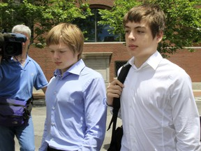 Alex Vavilov, right, and his older brother brother Tim leave a federal court after a bail hearing for their parents Donald Heathfield and Tracey Ann Foley, in Boston, Massachusetts on July 1, 2010.