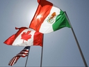 National flags of the United States, Canada, and Mexico fly in the breeze in New Orleans on April 21, 2008.
