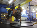 A YouTube video shows a physical altercation between two men at a Buzzfit gym in Montreal.