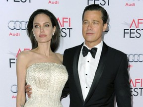 """In this Nov. 5, 2015 file photo, Angelina Jolie, left, and Brad Pitt arrive at the 2015 AFI Fest opening night premiere of """"By The Sea"""" in Los Angeles."""