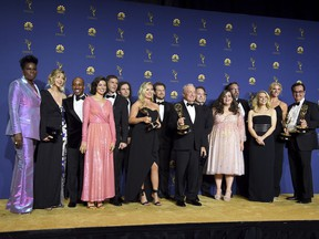 """Lorne Michaels, centre, and the cast and crew from """"Saturday Night Live"""" pose backstage with the award for outstanding variety sketch series at the 70th Primetime Emmy Awards, at the Microsoft Theater in Los Angeles, on Monday, Sept. 17, 2018."""