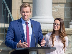 New Brunswick Liberal Leader Brian Gallant and wife Karine Lavoie, right, addresses the media after meeting with Lieutenant Governor of New Brunswick Jocelyne Roy-Vienneau, in Fredericton on Tuesday, Sept. 25, 2018.